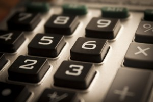 Austin Expert Witness and forensic Accounting by Mike Turner using calculator