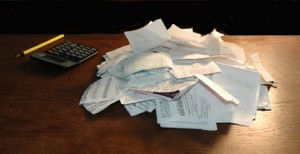 pile of receipts table for business valuation accounting in Austin Tx